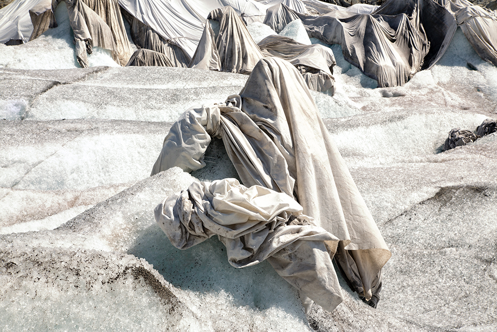 Incredible pictures show how one of The Swiss Alps oldest glaciers is being protected from melting - by covering it in BLANKETS